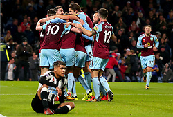 Jeff Hendrick of Burnley celebrates with teammates after scoring a goal to make it 1-0 as DeAndre Yedlin of Newcastle United cuts a dejected figure - Mandatory by-line: Robbie Stephenson/JMP - 30/10/2017 - FOOTBALL - Turf Moor - Burnley, England - Burnley v Newcastle United - Premier League