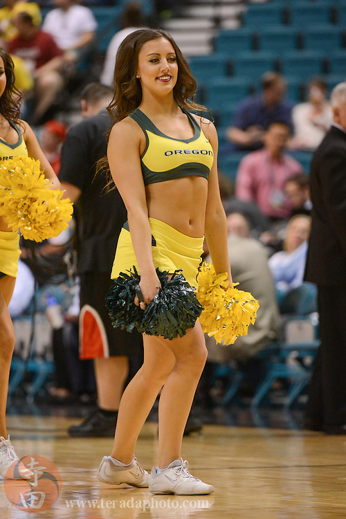 Mar 12, 2014; Las Vegas, NV, USA; Oregon Ducks cheerleader performs during the first half against the Oregon State Beavers in the first round of the Pac-12 Conference Tournament at MGM Grand Garden Arena. The Ducks defeated the Beavers 88-74.