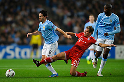 Man City Midfielder Samir Nasri (FRA) is tackled by Bayern Defender Philipp Lahm (GER) during the first half of the match - Photo mandatory by-line: Rogan Thomson/JMP - Tel: Mobile: 07966 386802 - 02/10/2013 - SPORT - FOOTBALL - Etihad Stadium, Manchester - Manchester City v Bayern Munich - UEFA Champions League Group D.