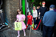 Georgia (11, wearing a pink Lolita dress) and brother Kiefer (8, wearing a red Liverpool Football Club kit) spending a day out together in Camden Town, North London. The family go to their favourite shop 'Cyberdog' where everything on sale is futuristic. The kids each get an inexpensive gift and happily leave the shop. Louise is on various benefits to help support her family income, and housing, although recent government changes to benefits may affect her family drastically, possibly meaning they may have to move out of London. Louise Ryan was born on the Wirral peninsula in 1970.  She moved to London with her family in 1980.  Having lived in both Manchester and Ireland, she now lives permanently in North London with her husband and two children. Through the years Louise has battled to recover from a serious motorcycle accident in 1992 and has recently been diagnosed with Bipolar Affective Disorder. (Photo by Mike Kemp/For The Washington Post)