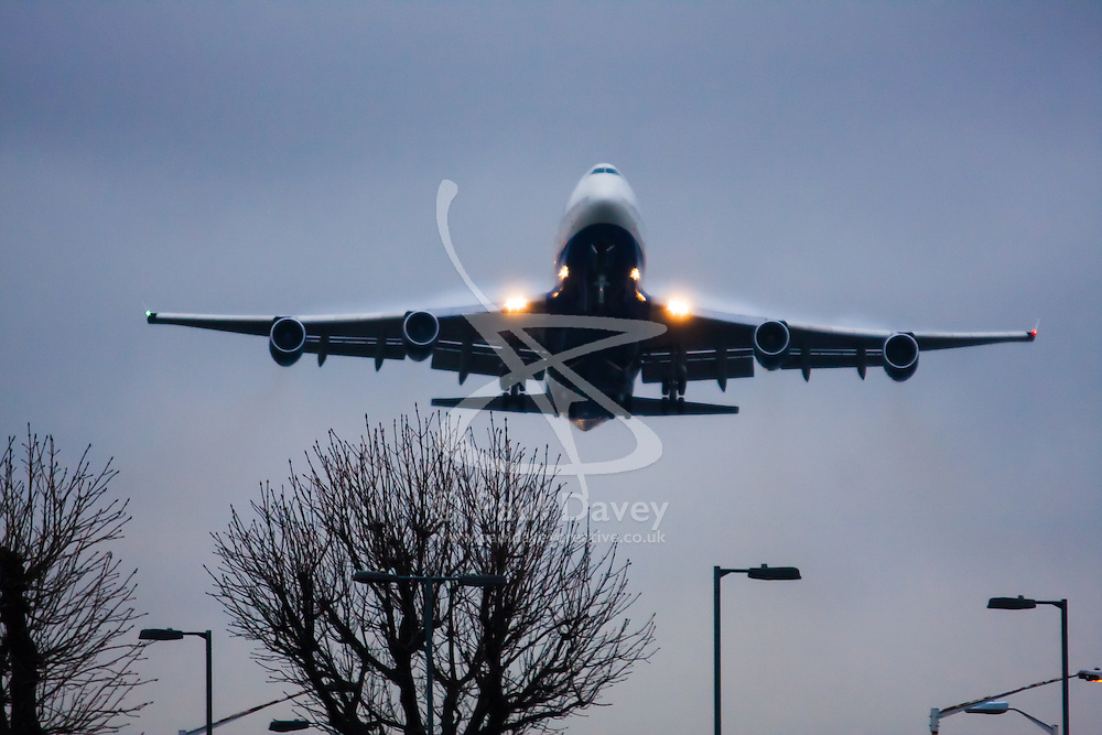 """January 3rd 2015, Heathrow Airport, London. Low cloud and rain provide ideal conditions to observe wake vortexes and """"fluffing"""" as moisture condenses over the wings of landing aircraft. With the runway visible only at the last minute, several planes had to perform a """"go-round"""", abandoning their first attempts to land. PICTURED: With water vapour """"fluffing"""" over its wing surfaces, a British Airways Boeing 747 Jumbo Jet takes off from London Heathrow."""