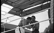 Ali vs Lewis Fight, Croke Park,Dublin.<br /> 1972.<br /> 19.07.1972.<br /> 07.19.1972.<br /> 19th July 1972.<br /> As part of his built up for a World Championship attempt against the current champion, 'Smokin' Joe Frazier,Muhammad Ali fought Al 'Blue' Lewis at Croke Park,Dublin,Ireland. Muhammad Ali won the fight with a TKO when the fight was stopped in the eleventh round.<br /> <br /> Picture shows Ali landing a left to the ribs of Lewis.