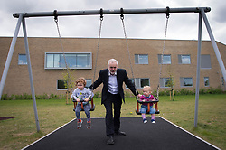 Labour leader Jeremy Corbyn with the children of Labour candidate for Oxford East, Anneliese Dodds, Freddie and Isabella (right) at Rose Hill Community Centre, Oxford.