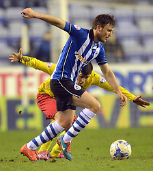 Watford's Fernando Forestieri competes with Wigan's William Kvist - Photo mandatory by-line: Richard Martin-Roberts/JMP - Mobile: 07966 386802 - 17/03/2015 - SPORT - Football - Wigan - DW Stadium - Wigan Athletic  v Watford - Sky Bet Championship