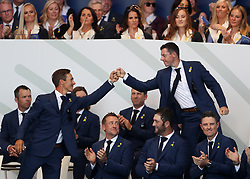 Team Europe's Rory McIlroy and Team Europe's Thorbjorn Olesen bump fists during the Ryder Cup Opening Ceremony at Le Golf National, Saint-Quentin-en-Yvelines, Paris.