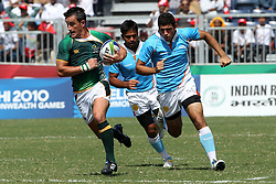 Marthinus Mentz attacks for South Africa during the XIX Commonwealth Games 7s rugby match between South Africa and India held at The Delhi University in New Delhi, India on the  11 October 2010..Photo by:  Ron Gaunt/photosport.co.nz