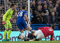 Football - 2016/2017 Premier League - Chelsea V Manchester United<br /> <br /> Gary Cahill of Chelsea and Zlatan Ibrahimovic of Manchester United tumble over in the penalty box at Stamford Bridge.<br /> <br /> COLORSPORT/DANIEL BEARHAM