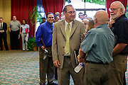 30 JULY 2012 - PHOENIX, AZ:  People wait in line before the Phoenix Job Fair in Phoenix, AZ. The job fair was sponsored by National Career Fairs, which organizes job fairs across the US. Several hundred people attended the job fair, with some arriving hours before it started. More than 30 employers and prospective employers were conducting interviews at the job fair. There were also resume coaches and educational institutions on site. Arizona is still grappling with the recession. The state's unemployment rate is stuck at 8.2% and the Phoenix metropolitan area has one of the highest home foreclosure rates in the United States.     PHOTO BY JACK KURTZ