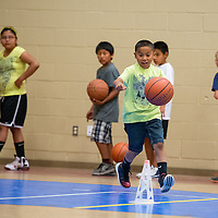 060613       Brian Leddy<br /> Oistin Charleston practices a dribbling exercise during a basketball camp at Rehoboth Thursday. The camp was for third to fifth-graders.