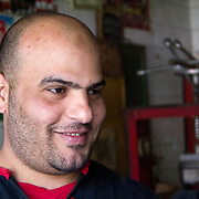 Talking hope and vision with Egyptian tyre repairer Khaled Sayed. Maadi, Cairo.