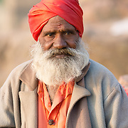 Indian sadhu in red turban at the village of Orchha