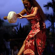KAUAI, HI, July 14, 2007: A Polynesian dancer entertains at sunset at the Hyatt Regency Resort and Spa on island of Kauai in Hawaii. (Photograph by Todd Bigelow/Aurora)