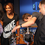 Defending US Open Champions Andy Murray looks at the names on the Ladies trophy trophy after a photo shoot with Serena Williams at the 2013 US Open draw ceremony. Flushing. New York, USA. 22nd August 2013. Photo Tim Clayton