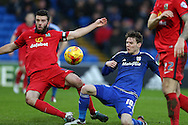 Joe Mason of Cardiff city (10) has a shot at goal blocked by Grant Hanley of Blackburn Rovers. Skybet football league championship match, Cardiff city v Blackburn Rovers at the Cardiff city stadium in Cardiff, South Wales on Saturday 2nd Jan 2016.<br /> pic by Andrew Orchard, Andrew Orchard sports photography.