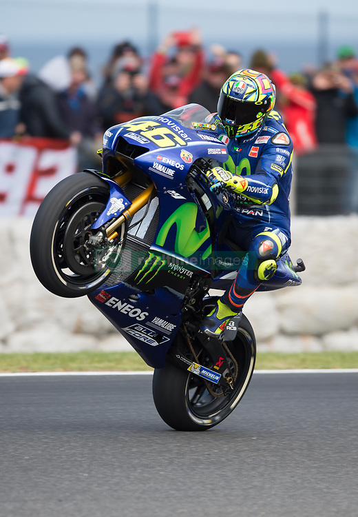October 21, 2017 - Melbourne, Victoria, Australia - Italian rider Valentino Rossi (#46) of Movistar Yamaha MotoGP does a wheelie after the second qualifying practice session at the 2017 Australian MotoGP at Phillip Island, Australia. (Credit Image: © Theo Karanikos via ZUMA Wire)