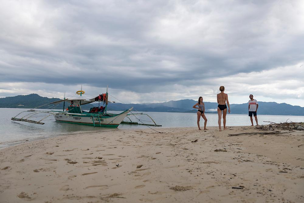 Three tourists make a stop on Capsalay Island, near Port Barton, Palawan, Philippines.<br /><br />(July 7, 2019)