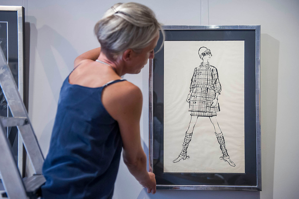 Todd Draz (1917 -2002 ), Original Fashion Illustration Commissioned for Sunday Times Fashion Page, Model Wearing Spanish Fashion Design of Checked Suit & Boot Covers, C1960's. Drawing on Style: Four Decades of Elegance - an exhibition of original vintage fashion illustrations from Post War 1940s through to the 1970s organized by GRAY M.C.A, leading specialists in Fashion Illustration.  It includes more than 40 original works by some of the leading illustrators of the time from Britain, Europe and America including René Bouché, René Gruau and Carl Erickson for publications including Vogue as well as advertising work for L'Oreal and other famous names in Haute Couture.  There are also a selection of original designs by designers including Dior, Biba & Zandra Rhodes. Coinciding with London Fashion Week, the exhibition runs from Thursday 11th - Tuesday 16th September 2014 with prices from £300-£10,000. Gallery 8, St James's, London. 10 Sept 2014. Guy Bell, 07771 786236, guy@gbphotos.com