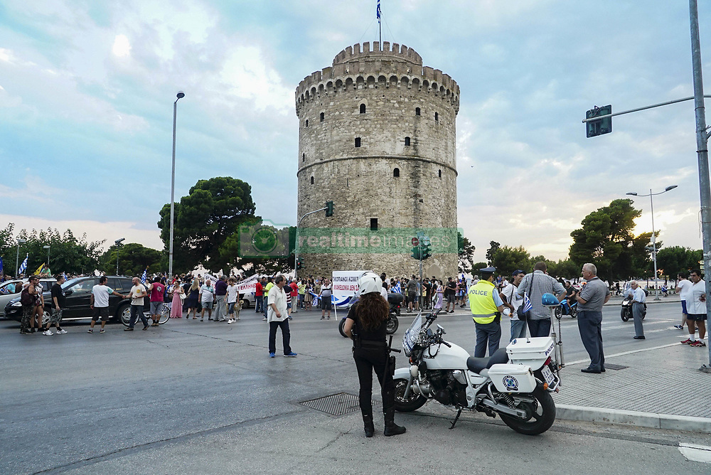 July 4, 2018 - Thessaloniki, Greece - The prime ministers of Greece, Bulgaria, Romania and Serbia held a meeting in Thessaloniki city, Greece, on July 4, 2018. During the meeting, nationalists groups protested and tried to reach the meeting point near the airport where huge police force was developed there. The protest is about the use of the name Macedonia in the neighboring country, FYROM. The protest continued in Thessaloniki city after a fight with some anarchists. The protest passed in front of the Holocaust memorial and some people threw bottles. Traffic was stopped in many locations in the city due to the protest, from 17:00 to 23:30  (Credit Image: © Nicolas Economou/NurPhoto via ZUMA Press)