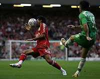 Photo: Paul Thomas.<br /> Liverpool v Maccabi Haifa. UEFA Champions League Qualifier. 09/08/2006.<br /> <br /> Jermaine Pennant (L) of Liverpool just gets out of the way of Haim Magrashvili cross pass.