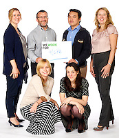Group shot featuring pharmaceuticals team of Bristol Myres Squibb shot against pure white background