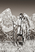 Young Mountain Man in the Grand Teton valley, setting traps and hunting along the streams and creeks.