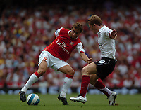 Photo: Tony Oudot. <br /> Arsenal v Fulham. Barclays Premiership. 12/08/2007. <br /> Mathieu Flamini of Arsenal moves past Brian McBride of Fulham