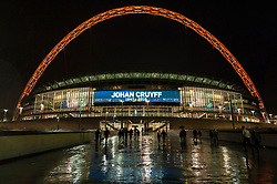 © Licensed to London News Pictures. 29/03/2016. London, UK. The friendly match at Wembley Stadium between England and the Netherlands is paused during the 14th minute for a minute's applause, as a tribute to the Dutch football legend, Johan Cruyff.  The Wembley arch is lit up in pink as a mark of respect to Cruyff, who wore the number 14 shirt for the Dutch national team and who passed away from cancer recently.  Photo credit : Stephen Chung/LNP