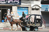 horse-drawn cart bears the old car structure