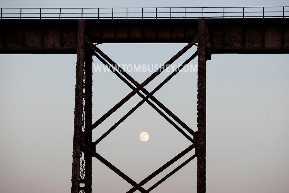 Salisbury Mills, New York - The nearly full moon rises behind the Moodna Viaduct railroad trestle on Nov. 20, 2010.