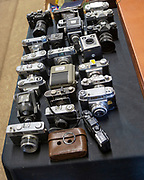 Vintage camera collection on table for sale at auction, Suffolk, England, UK