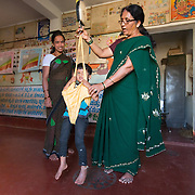 CAPTION: Under the Chamkol programme, anganwadi (pre-school) workers like Shashikala will soon start receiving focussed training on ways to minimise the risk of disability during pregnancy, childbirth or infancy, on how to identify and respond to suspected impairments and how to care for, nurture and support children with different impairments. LOCATION: Uttuvalli (village), Kasaba (hobli), Chamrajnagar (district), Karnataka (state), India. INDIVIDUAL(S) PHOTOGRAPHED: From left to right: Pavitra, Komala and N. Shashikala.
