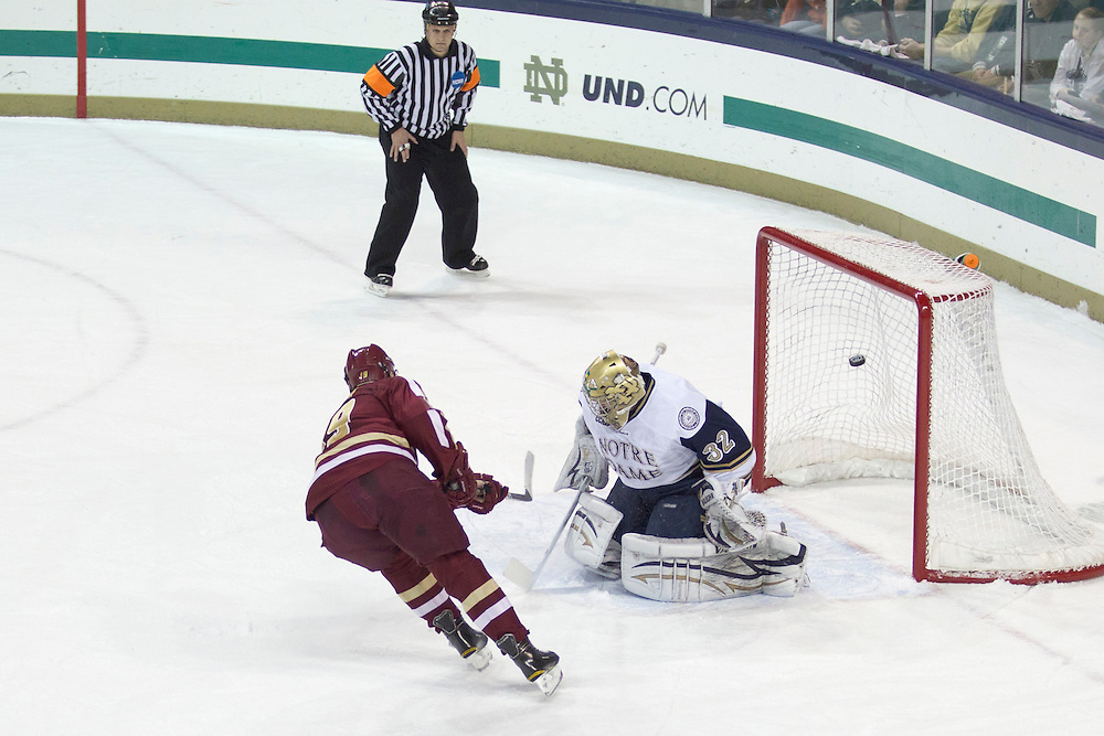 Boston College forward Chris Kreider (#19) scores on a penalty shot past Notre Dame goaltender Mike Johnson (#32) in action during NCAA hockey game between Notre Dame and Boston College.  The Notre Dame Fighting Irish defeated the Boston College Eagles 3-2 in game at the Compton Family Ice Arena in South Bend, Indiana.