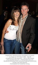 Singer PAUL YOUNG and his wife STACEY at a party in London on 17th March 2004.PSN 89