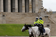 MELBOURNE, VIC - SEPTEMBER 12: Mounted Police stand at The Shrine during the Melbourne Freedom Walk Rally on September 12, 2020 in Melbourne, Australia. Stage 4 restrictions are in place from 6pm on Sunday 2 August for metropolitan Melbourne. This includes a curfew from 8pm to 5am every evening. During this time people are only allowed to leave their house for work, and essential health, care or safety reasons. Despite this, multiple protests are being arranged to push back against the draconian restrictions in place within metropolitan Melbourne. A Freedom Walk was arranged to take place in the Tan but with hundreds of police and wet weather forecast, only a small number of protesters tried to attend before being ordered to move on. (Photo by Dave Hewison/Speed Media)