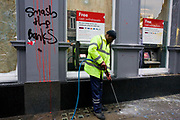 Cleaning up street the morning after the TUC-organised anti-government cuts to Britain's economy.<br /> The words Smash the Bank have been sprayed with aerosol on wall relating to the belief by protesters that HSBC is a tax-evader. The riot by anarchists who broke away from a largely peaceful protest agasinst government economic cuts. Organisers estimated between 250,000 and 500,000 people took part but police said a total of 201 arrests had been made during the day largely for a variety of public order offences, they said. In addition, 66 people were reported to have been injured, including at least 31 police officers, 11 of whom required hospital treatment.