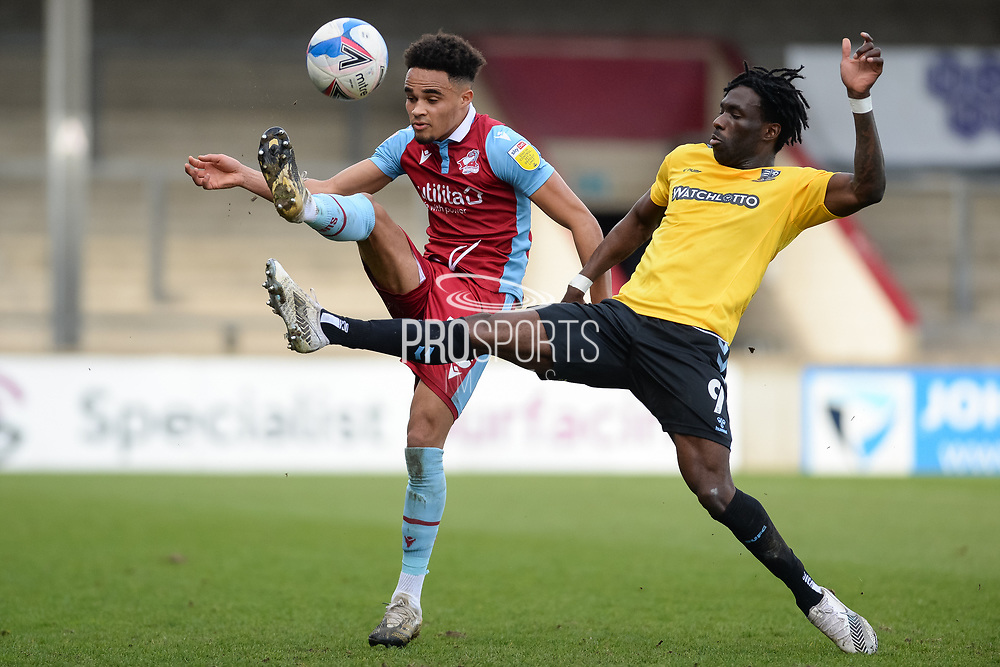 Scunthorpe United Jai Rowe (25) Southend United Simeon Akinola (9) battles for possession during the EFL Sky Bet League 2 match between Scunthorpe United and Southend United at the Sands Venue Stadium, Scunthorpe, England on 20 March 2021.