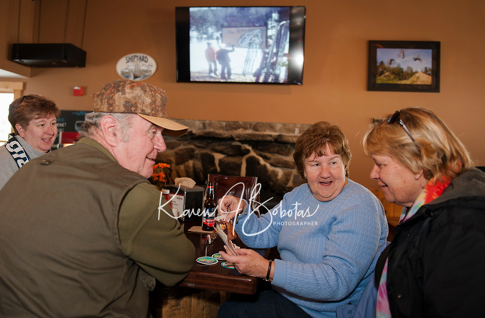 """Dawna Gauvin, Howard and Claire Smith and Judy Dupuis reminisce from """"back then"""" in 1969 when they were skiing at Highlands Mountain Bike Park at the 50th anniversary celebration on Saturday.  (Karen Bobotas/for the Laconia Daily Sun)"""