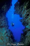 diver uses scooter to explore coral crevasse,<br /> Grand Turk, Turks & Caicos Islands,<br /> ( Western Atlantic Ocean )  MR 44