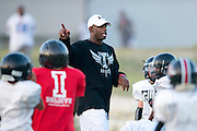 Deion Sanders coaches kids during football practice for Truth, a non-profit sports organization Sanders founded, at the Prime Prep Academy campus in Dallas, Texas on August 6, 2014. (Cooper Neill for The New York Times)