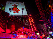 27 FEBRUARY 2019 - BANGKOK, THAILAND: Bar fronts on Soi Cowboy in Bangkok. Bangkok, a city of about 14 million, is famous for its raucous nightlife. But Bangkok's real nightlife is seen in its markets and street stalls, many of which are open through the night.         PHOTO BY JACK KURTZ