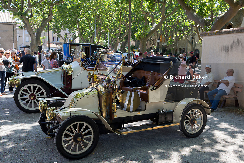 A 1908 Renault Type AX vintage car visits a rural French village, during a three-day rally journey through the Corbieres wine region, on 26th May, 2017, in Lagrasse, Languedoc-Rousillon, south of France. Lagrasse is listed as one of France's most beautiful villages and lies on the famous Route 20 wine route in the Basses-Corbieres region dating to the 13th century.