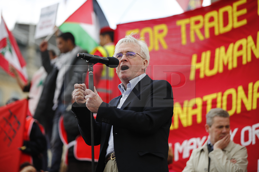 © Licensed to London News Pictures. 01/05/2017. London, UK. Shadow Chancellor JOHN MCDONNELL speaks to workers and activists at a May Day march at Trafalgar Square in London on May 1, 2017. Photo credit: Tolga Akmen/LNP