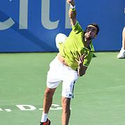 MARIN CILIC hits a serve at the Rock Creek Tennis Center.