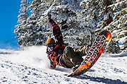 Oliver Rudd snowboards on opening day of Aspen Mountain. Rudd lives in Carbondale, Colorado. He's a passionate snowboarder and surfer.