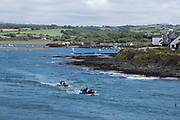 Views from the coastal path out to sea as boats pass Parrog on 17th August 2021 in Newport, Pembrokeshire, Wales, United Kingdom. Newport is a town, parish, community, electoral ward and ancient port of Parrog, on the Pembrokeshire coast in West Wales at the mouth of the River Nevern in the Pembrokeshire Coast National Park.