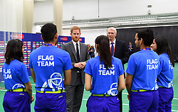 The Duke of Sussex speaks to flag bearers as he attends the opening match of the 2019 ICC Cricket World Cup between England and South Africa at The Oval in London.