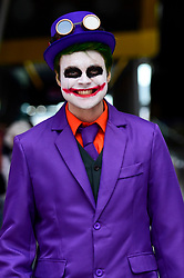 © Licensed to London News Pictures. 24/05/2019. LONDON, UK.  A cosplayer dressed as The Joker attends the opening day of the bi-annual MCM Comic Con event at the Excel Centre in Docklands.  The event celebrates popular culture such as video, games, manga and anime providing many attendees with the opportunity to dress up as their favourite characters.  Photo credit: Stephen Chung/LNP