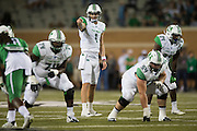 Marshall Thundering Herd quarterback Chase Litton (1) calls a play at the line of scrimmage against the North Texas Mean Green during the 1st half at Apogee Stadium in Denton, Texas on October 8, 2016. (Cooper Neill for The Herald-Dispatch)