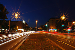 Traffic light trails on the road at night, Berlin, Germany