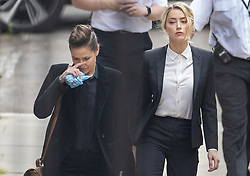 © Licensed to London News Pictures. 24/07/2020. London, UK. American actor AMBER HEARD (R) and Bianca Butti arrive at the High Court in London where Johnny Depp is in a legal dispute with UK tabloid newspaper The Sun over allegations he assaulted his former wife, Amber Heard. Photo credit: Peter Macdiarmid/LNP